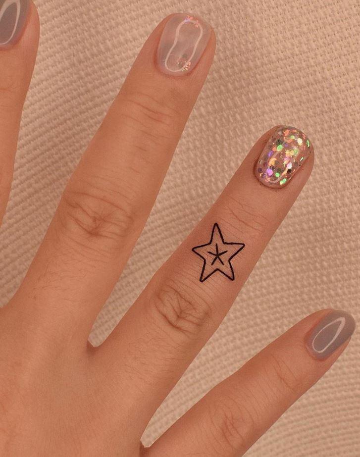 Tiny Star Tattoo